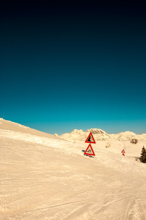 massive: after an heavy snowfall the road is completely buried as the road signals Stock Photo