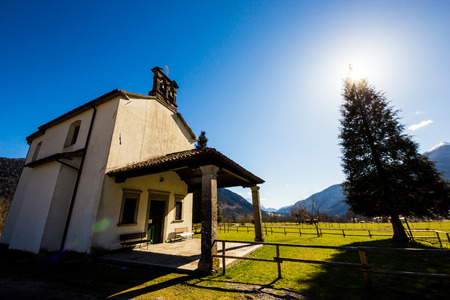 little church in the meadows of Dolomiti Friulane, Italy photo