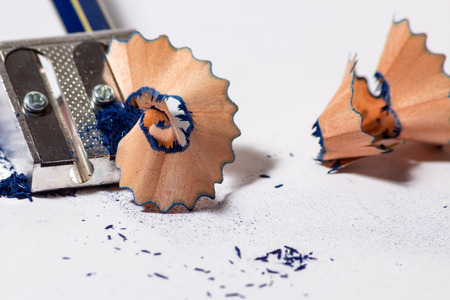 wood shavings: a pencil with an iron sharpener