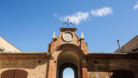 A broken clock in a medieval palace of Recanati, Italy photo