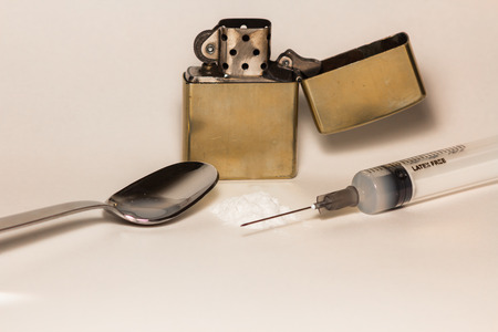 heroin: Lighter, spoon and heroin, with a syringe for the injection
