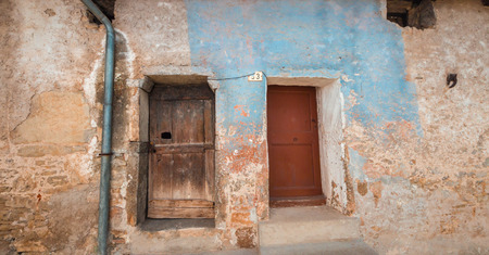Doors and windows of an ancient house in a little village of italy photo