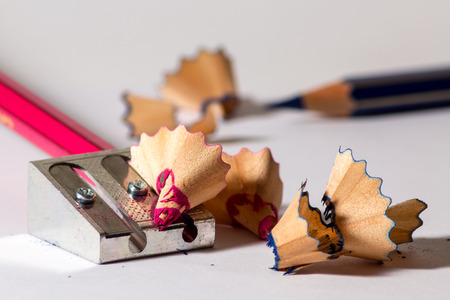 sharpener: Two pencils with an iron sharpener