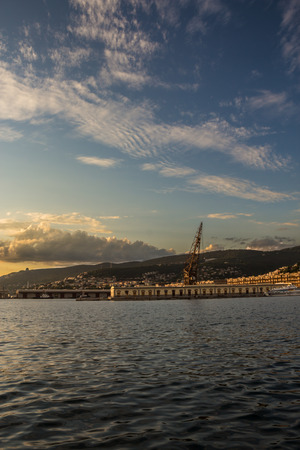 an old crane in the docks of Trieste, Italy photo