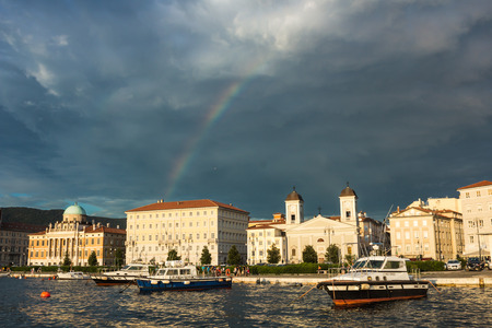 Storm is passed, rainbow on the city of Trieste photo