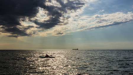 man with kayak in a summer evening photo