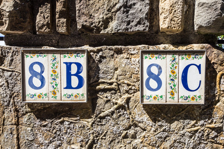 8b and 8c numbers on a street of Muggia, Trieste photo