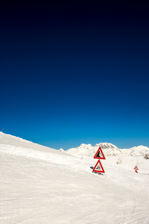 after an heavy snowfall the road is completely buried as the road signals photo