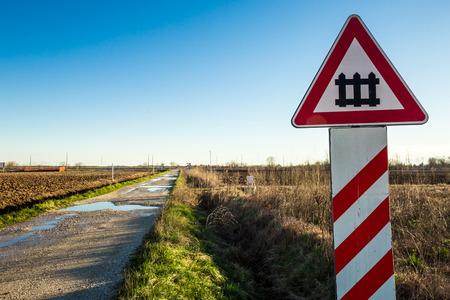 an isolated railroad crossing in the plan of Friuli Venezia-Giulia. photo