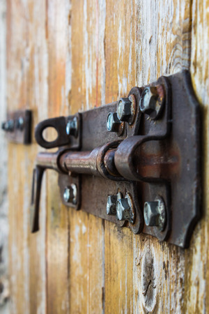 iron latch on an old wood door photo