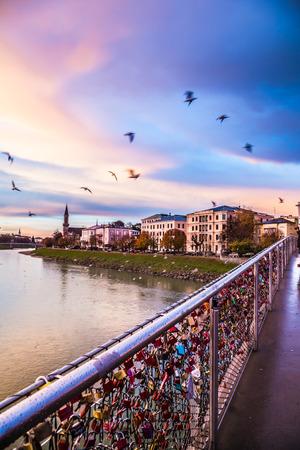 Padlocks of love on a bridge on Salzach River, Salzburg, Austria