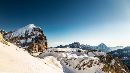 winter in the italian alps, with the ski slope full of snow photo