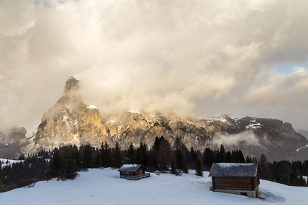 wood cottage in the dolomiti photo