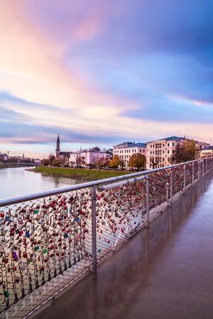 Padlocks of love on a bridge on Salzach River, Salzburg, Austria photo