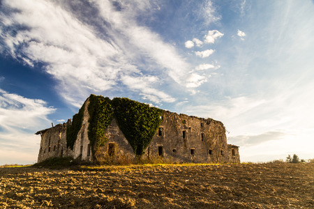 an abandoned and ruined farm in the fields of Italy photo