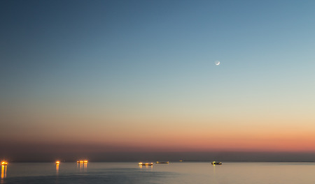 young moon over the sea of Trieste photo