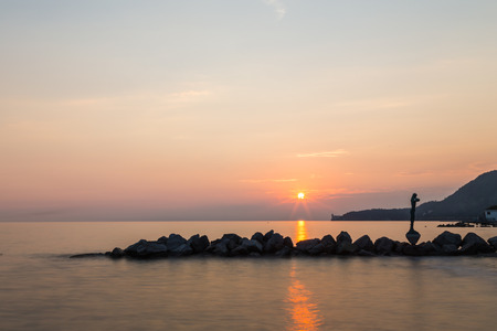 sun goes down in the bay of Trieste Italy photo