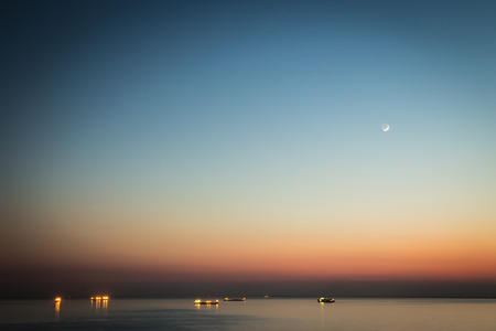 trieste: young moon over the sea of Trieste