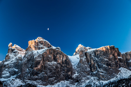 mountains and sky: a windy winter evening in the italian alps