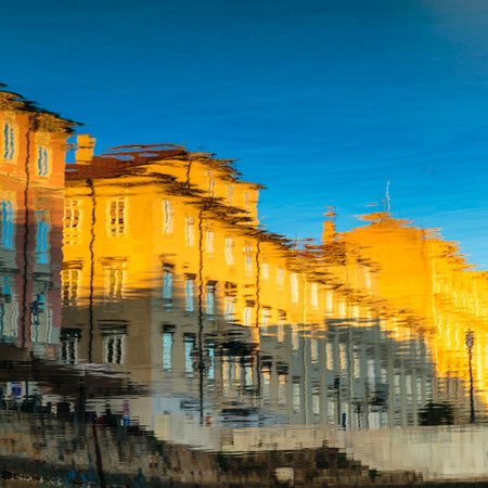 trieste: sun goes down and paints colors on the wall of the buildings of Trieste Stock Photo