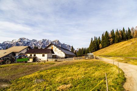alpine hut: Alpine hut with a bench in the italian alps.