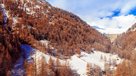 an artificial lake in the italian alps in a winter day Stock Photo