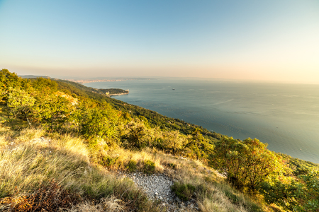 castle rock: evening in the bay of Trieste in a summer day Stock Photo