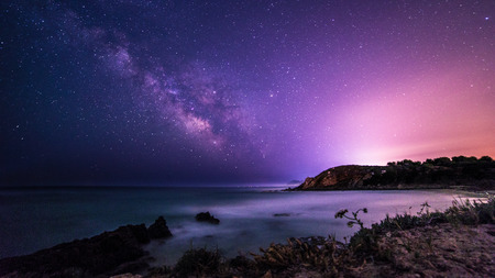 A beautiful milky way in the sky of Sardinia in a day of summer 스톡 콘텐츠