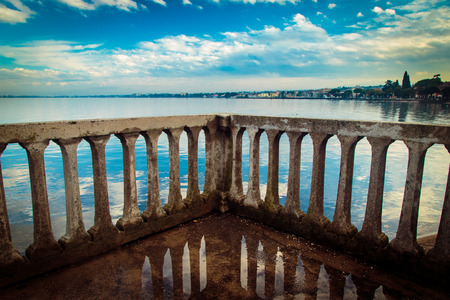 dominant: reflection of the lake of Garda, in the town of Desenzano Stock Photo
