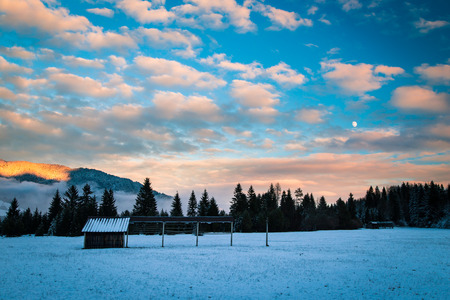 winter sunrise: sunset after the first snowfall in the italian alps