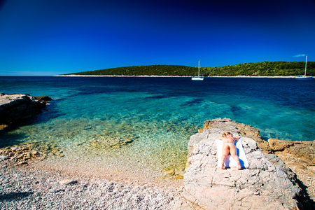 A beautiful blonde girl relaxing in the croatian sea