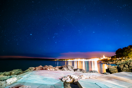 Stars in the night of Krk with Losini island in the background