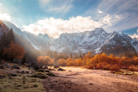 sun rise behind the peak in a colorful autumn morning