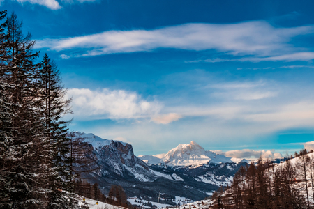 Sun goes down on an alpine valley in italy during a snowy winter Banco de Imagens - 120384180