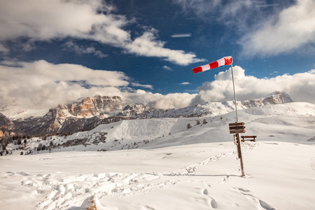 A windsock in the italian alps in a winter day