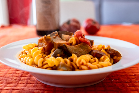 Pasta alla norma, with tomatoes and eggplants, a recipie from sicily Foto de archivo