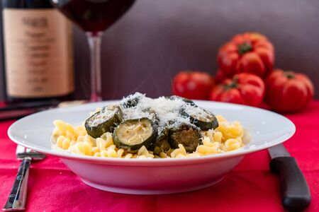 Pasta with zucchini on an italian table