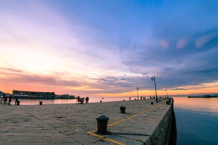 The Molo Audace pier of Trieste in a winter evening 스톡 콘텐츠 - 132221713