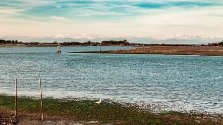Sun goes down on the lagoon of Grado in a spring day