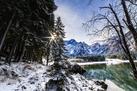 First snow of the winter at a lake in the italian alps