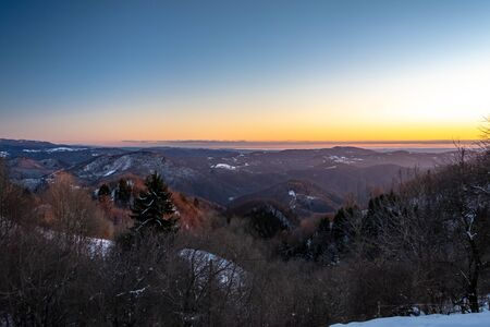 Sunset in the hills between Slovenia and Italy in a freezing winter day Banco de Imagens