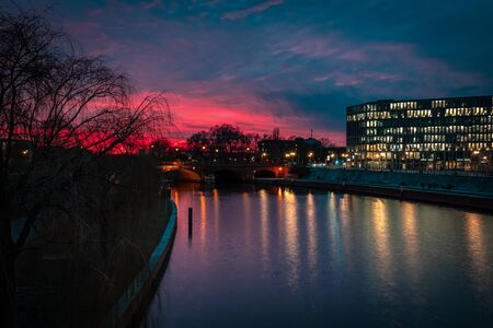 The sky is colorful over Berlin in a winter evening