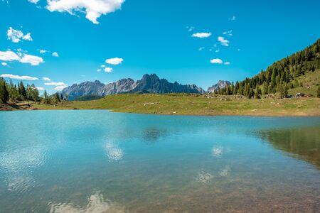 May sunny day at the lake in the alps of Friuli-Venezia Giulia, Italy