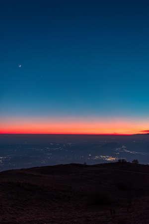 Sunset at the Cuarnan peak, Friuli-Venezia Giulia Region, in a freezing winter day Фото со стока