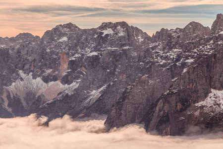 Clouds in the valley under the peak of Julian Alps 免版税图像