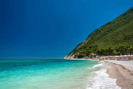 The bay of Portonovo with the Conero mount in the background in a beautiful summer day