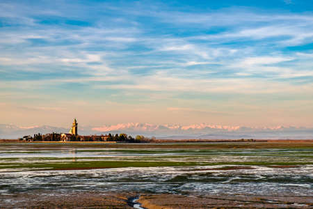 The ancient Sanctuary of Barbana with snowy mountains in the background Imagens
