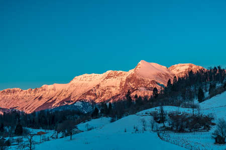 Sunset in the mountains between Slovenia and Italy in a freezing winter day