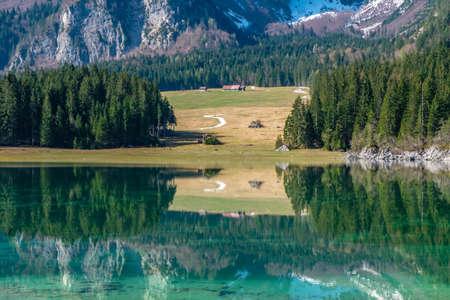 Spring morning at the superior lake of Fusine, Friuli Venezia-Giulia, Italy Imagens
