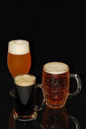 ingredients tap: light beer, dark beer on dark background Stock Photo